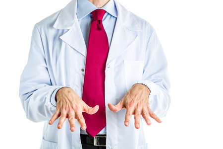 certainty: Caucasian male doctor dressed in white coat, blue shirt and red tie is making palms down gesture to point out certainty of what is said Stock Photo
