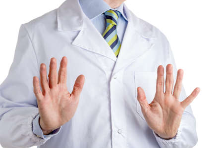 medical attention: Man dressed with medical white coat, light blue shirt and glossy regimental tie with dark blue, light blue and green stripes, is showing palms to  viewers  making a  gesture to drive attention what is said