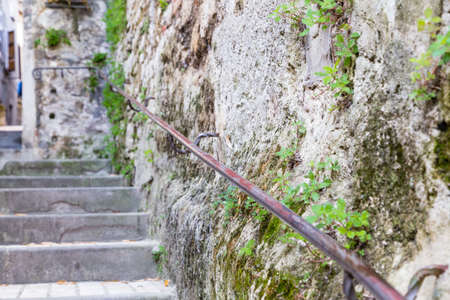 handrails: Ancient stone stairs with handrails in a street in the old town of a country village in countryside of Romagna