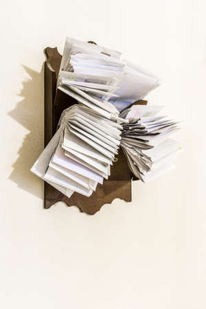 bunches: bunches of old bills and accounts  in dusty original envelopes collected in wood support