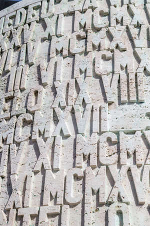 numerals: A background of  Roman numerals and letters set in stone Stock Photo