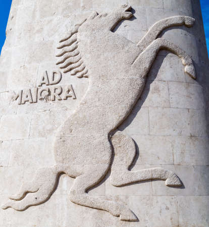 embossed: prancing horse with ad maiora sentence embossed in stone Stock Photo