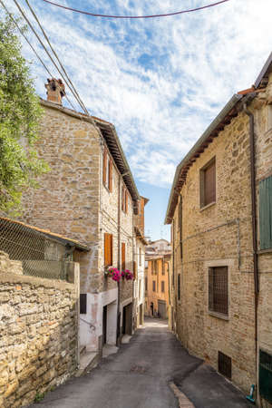 facing each other: Old houses facing each other in a street in the old town of a country town in Italian countryside