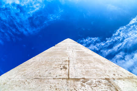 vanishing point: A long stone tip going to vanishing point at the horizon on a sky background Stock Photo