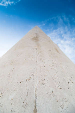 vanishing: A long stone tip going to vanishing point at the horizon on a sky background Stock Photo