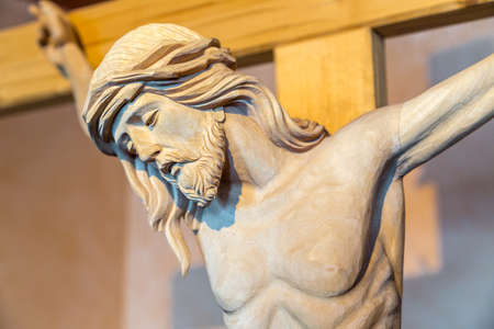 A wood carved statue  of the Crucifixion of Jesus Christ