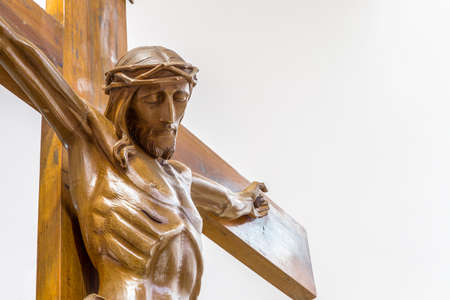 crucify: A wood carved statue  of the Crucifixion of Jesus Christ