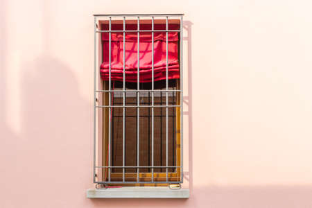 iron curtain: Iron grating window with red curtain