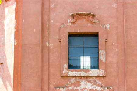 severe: Window of the rigid and severe architecture of the Shrine of Our Lady of Health of Solarolo in Italy, church from the 18th century devoted to the Blessed Virgin Mary