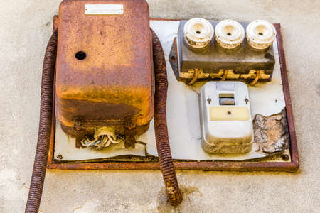 insecure: Electrotechnical industrial archeology - old electric light switch and electrical panel with valves and fuses