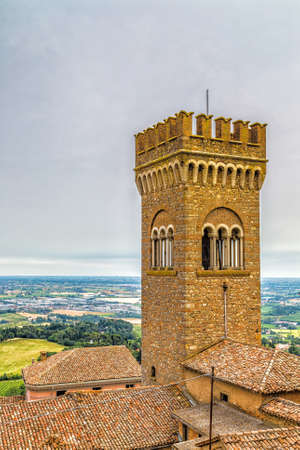 civic: architecture in the Middle Ages - the civic tower adjacent to the town hall of bertinoro with its characteristic brick walls