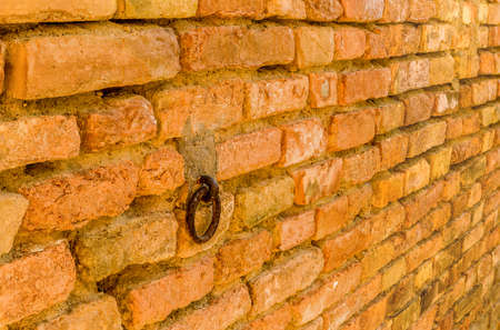 farmhouses: old iron ring used to tie cattle in the old farmhouses of the peasants