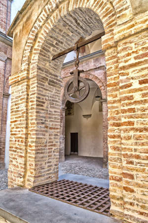 bordered: The courtyard with center shaft of The Praetor Palace represents Italian Renaissance architecture with elements of stone and brick  and it is bordered by triportico with two orders, Doric and Ionic, columns. Editorial