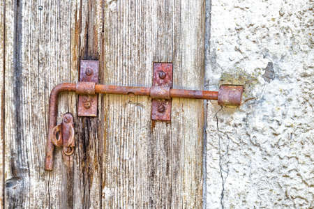 14th: Rusty bolt of the door of an 14th century mill in Italian countryside Stock Photo