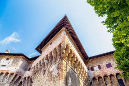 terra: the sharp edges of the walls of the brick walls of The Castle of the Captain of Artillery, a 16th century stronghold in Terra del Sole, a small village in Emilia Romagna in Italy
