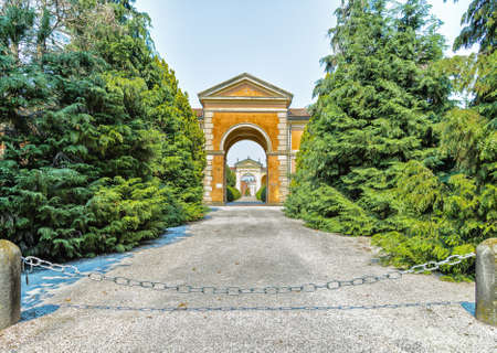 bollards: Entry to a cemetery in the Italian countryside Stock Photo