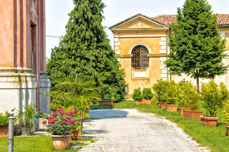 rigid: Cemetery near the rigid and severe architecture of the Shrine of Our Lady of Health of Solarolo in Italy, church from the 18th century devoted to the Blessed Virgin Mary