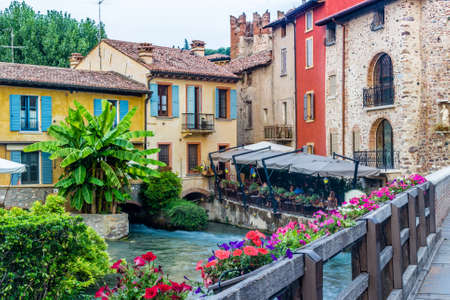 ancient buildings of a typical Italian medieval village: the river runs through the town, still passing under houses and old mills