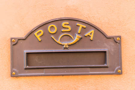 slit: slit for inserting mail in a vintage mailbox with Italian word meaning Post Stock Photo