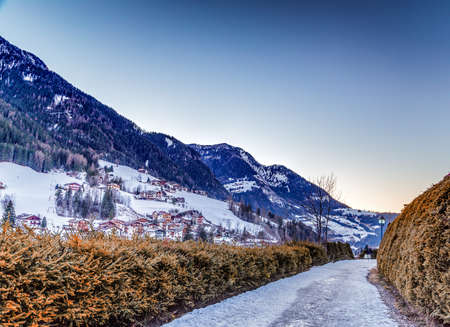 bordered: Snowy footpath bordered by hedges  on Dolomites snowy mountains in winter Stock Photo