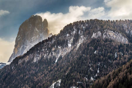 dolomite: Dolomite mountains covered with white snow and green conifers in Italy
