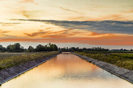 Channel to divert river water for irrigation of cultivated fields
