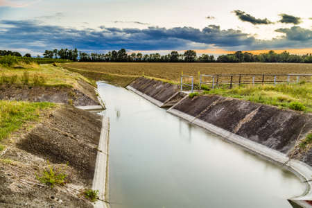 water flow: Channel to divert river water for irrigation of cultivated fields