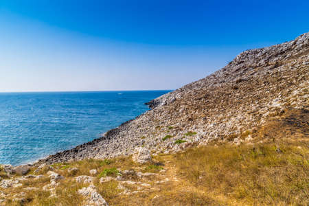 steep cliffs: steep cliffs above the sea along the coast of Puglia in Italy