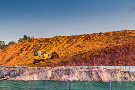 crushing: earth-moving machine accumulates marc and other waste of crushing grapes Stock Photo