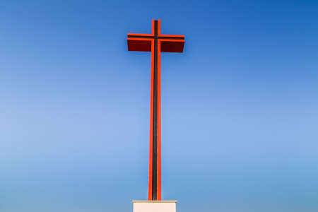 red and black steel crucifix in Italy