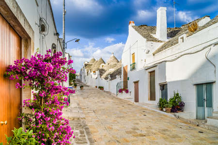 trulli: The Trulli of Alberobello in Apulia in Italy. These typical houses with dry stone walls and conical roofs are unique to the world and projecting this place outside of time and reality, somewhere between magic and history