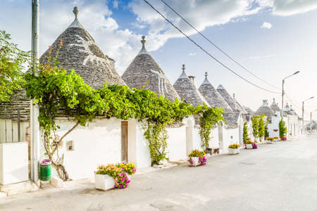 The Trulli of Alberobello in Apulia in Italy. These typical houses with dry stone walls and conical roofs are unique to the world and projecting this place outside of time and reality, somewhere between magic and history