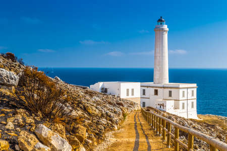 The lighthouse of Cape of Otranto in Apulia standing on hard granite rocks is the most easterly point of Italy and marks the meeting of the Ionian Sea and the Adriatic Sea