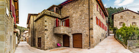 derived: Alleys in medieval mountain village in Tuscany characterized by houses with walls of stones derived from the Renaissance