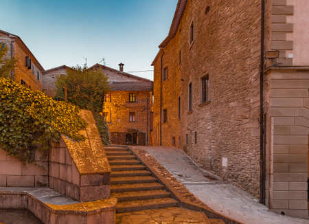 characterized: Alleys by night in medieval mountain village in Tuscany characterized by houses with walls of stones derived from the Renaissance Stock Photo