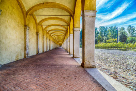 portico: perspective effect of the arches of an ancient portico in Italy