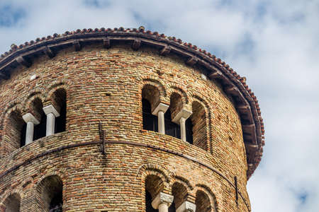 ninth: architecture details of cylindrical bell tower of the ninth century with mullioned windows