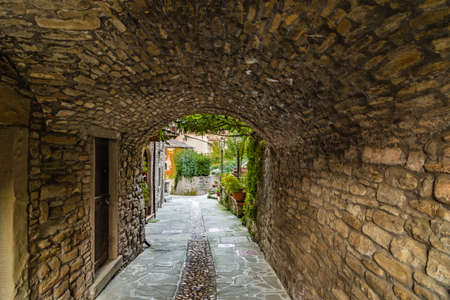 characterized: Alleys in medieval mountain village in Tuscany characterized by houses with walls of stones derived from the Renaissance