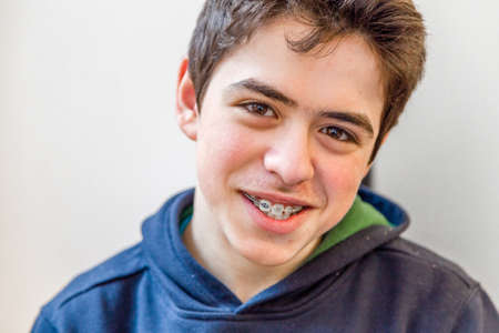 teeth braces: caucasian boy happy and smiling with braces on teeth
