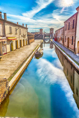 enchanting: the vibrant colors of the historic homes of Comacchio in Emilia Romagna, an enchanting lagoon city
