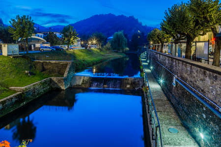 characterized: River runs thorugh medieval mountain village in Tuscany characterized by houses with walls of stones derived from the Renaissance. Night view