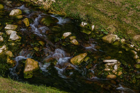 nestled: stream through medieval village nestled in the green hills of Romagna