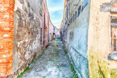 comacchio: Narrow alley in  Comacchio,  enchanting lagoon city Stock Photo