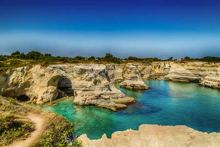 Rocky stacks of Santo Andrea on the coast of Salento in Puglia in Italy Banco de Imagens