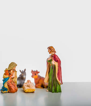 A simple Christmas Crib where the little statues represent the Holy Family, the Virgin Mary, Saint Joseph and the infant Jesus, watched by ox and donkey during the night of the 25th of December