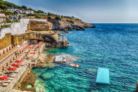 bathing facilities, rocks and architecture of the coast of Salento of the Ionian Sea in Italy,  in Santa Cesarea Terme, Lecce, Apulia Banco de Imagens