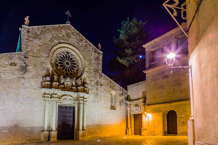 origins: Night view of the medieval Cathedral in the historic center of Otranto, coastal town of Greek-Messapian origins  in Italy Stock Photo