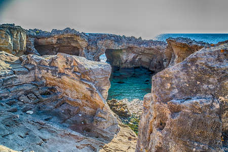 natural pool: Amazing natural pool surrounded only by the Adriatic  sea or by caves in Italy,  Marina Serra Tricase, Lecce, Apulia Stock Photo