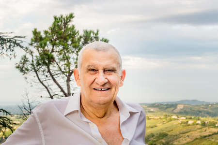 octogenarian: elderly octogenarian male smiling in the countryside Stock Photo
