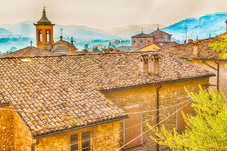 emilia romagna: The rooftops of ancient buildings and brick wall houses in Brisighella, hill village in Emilia Romagna in Italy